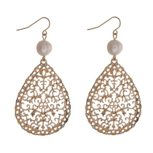 """Gold tone fishhook earrings with a filigree teardrop shape and a freshwater pearl bead. Approximately 3"""" in length."""