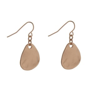 """Gold tone fishhook earrings with a hammered teardrop shape and a matte finish. Approximately 1"""" in length."""