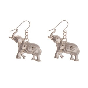 """Silver tone fishhook earrings with an elephant. Approximately 1"""" in length."""