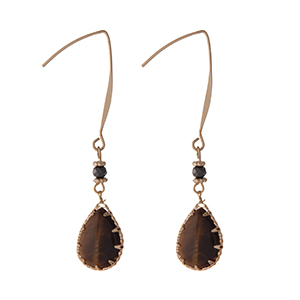 """Gold tone hook earrings with a tiger's eye semi-precious teardrop stone. Approximately 2"""" in length."""