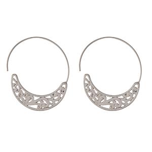 "Silver tone hoop earrings with a swirl pattern. Approximately 1.75"" in length."