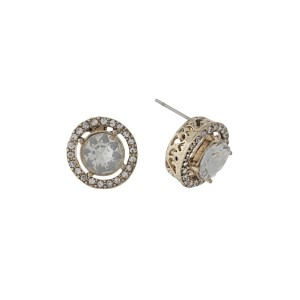 """Gold tone stud earrings with clear rhinestones and a clear center rhinestone. Approximately 1/2"""" in length."""