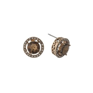 """Gold tone stud earrings with clear rhinestones and a topaz center rhinestone. Approximately 1/2"""" in length."""