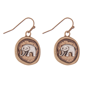 """Burnished gold tone fishhook earrings with a two tone elephant. Approximately 1"""" in length."""