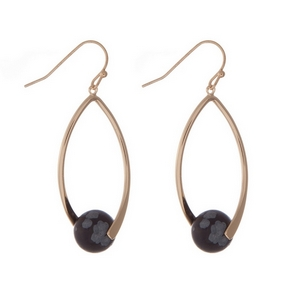 "Gold tone fishhook earrings with a black bead. Approximately 1.5"" in length."