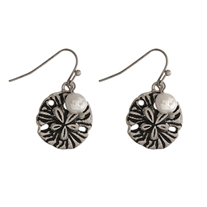 "Silver tone sand dollar earrings with a pearl bead accent. Approximately 1"" in length."