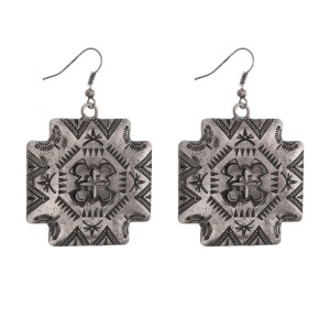 "Silver tone tribal print earrings. Approximately 2"" in length."