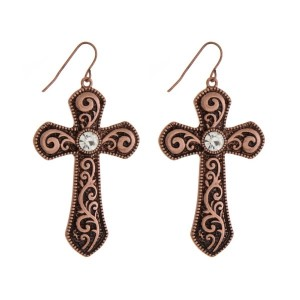 "Copper tone cross earrings with a clear rhinestone. Approximately 1.75"" in length."