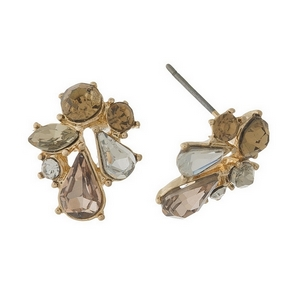 "Gold tone stud earrings featuring pink, gold, and clear glass faceted stones. 1/2"" in length."