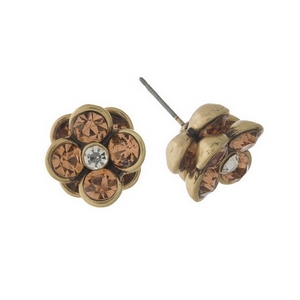 "Burnished gold tone, flower shaped, stud earrings with peach rhinestones. Approximately 1/2"" in diameter."