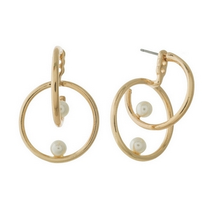 "Gold tone, double sided, hoop earrings with 6mm pearl bead accents. Approximately 1.25"" in length."