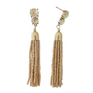 "Gold tone post style earrings with topaz rhinestones and a beaded tassel. Approximately 3.5"" in length."