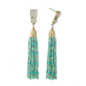 "Gold tone post style earrings with white opal rhinestones and a mint green beaded tassel. Approximately 3.5"" in length."