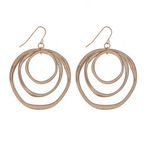 "Matte gold tone fishhook earrings with cascading circles. Approximately 1.5"" in length."