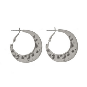 "Hammered silver tone hoop earrings. Approximately 1"" in length."