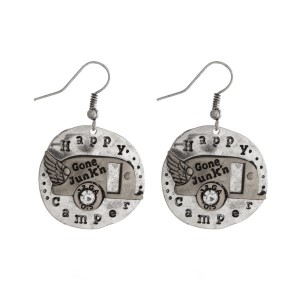 "Burnished silver tone fishhook earrings, stamped with ""Happy Camper."" Approximately 1"" in length."