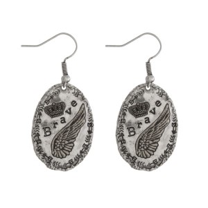 "Burnished silver tone fishhook earrings, stamped with ""Brave."" Approximately 1"" in length."