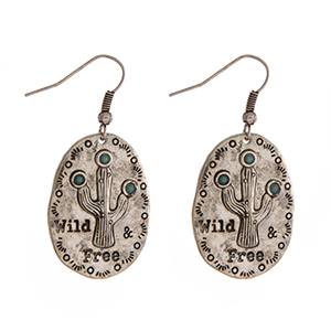 "Burnished silver tone fishhook earrings, stamped with ""Wild & Free."" Approximately 1"" in length."