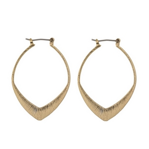 "Gold tone lever hook earrings. Approximately 1.25"" in length."