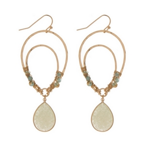"""Gold tone fishhook earrings with an upside down teardrop shape and mint green beads. Approximately 3"""" in length."""