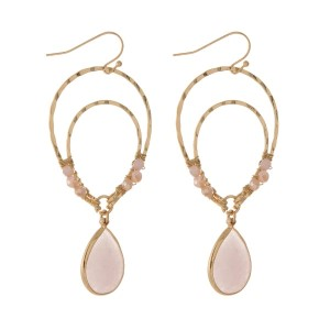 "Gold tone fishhook earrings with an upside down teardrop shape and blush pink beads. Approximately 3"" in length."