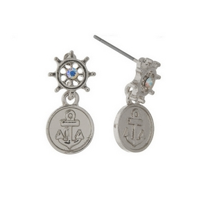 "Silver tone post style earrings with a captain's wheel, anchor, and iridescent rhinestone. Approximately 1"" in length."