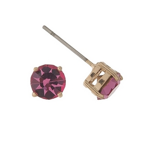 Gold tone stud earrings with a pink rhinestone. Approximately 7mm in size.