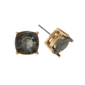"Gold tone stud earrings with a gray rhinestone. Approximately 1/2"" in width."