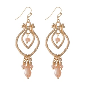 "Gold tone fishhook earrings with light pink beads. Approximately 2.5"" in length."