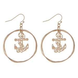 "Gold tone fishhook earrings with a hammered circle and a filigree anchor. Approximately 1.25"" in diameter."