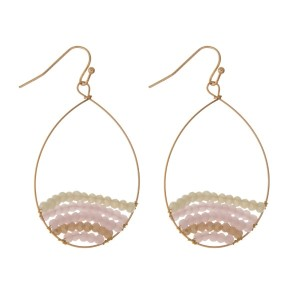 "Gold tone fishhook earrings with a pink and ivory beaded teardrop shape. Approximately 1.5"" in length."