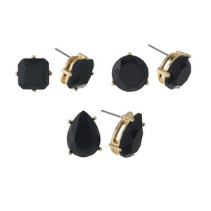"Gold tone stud earring set with three pairs of black studs. Approximately 1/2"" in size."