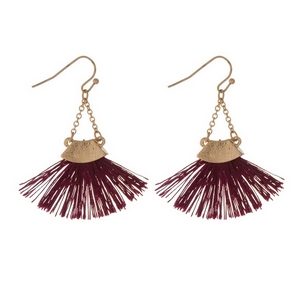 "Gold tone fishhook earrings with a burgundy fan tassel. Approximately 2"" in length."