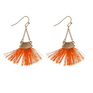 "Gold tone fishhook earrings with an orange fan tassel. Approximately 2"" in length."