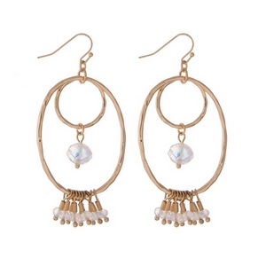"Gold tone fishhook earrings with an open oval shape and iridescent faceted beads. Approximately 2"" in length."