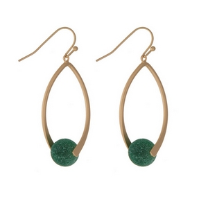 "Matte gold tone fishhook earrings with an oval shape and a jade natural stone bead. Approximately 1.5"" in length."