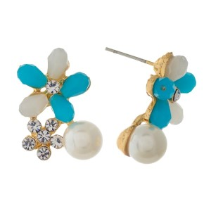 """Gold tone stud earrings with blue and clear rhinestones. Approximately 3/4"""" in length."""