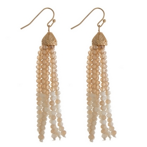 """Gold tone fishhook earrings with a topaz and ivory beaded tassel. Approximately 3"""" in length."""