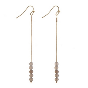 """Gold tone fishhook earrings with gray natural stone beads. Approximately 3"""" in length."""