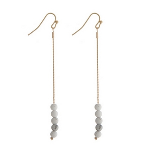 """Gold tone fishhook earrings with howlite natural stone beads. Approximately 3"""" in length."""
