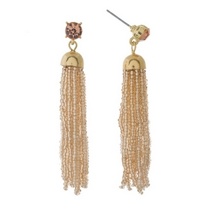 "Gold tone post style earrings featuring a peach beaded tassel and rhinestone accent. Approximately 2.5"" in length."
