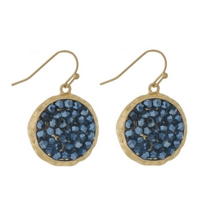 "Gold tone fishhook earrings featuring a hematite beaded circle. Approximately 1"" in diameter."