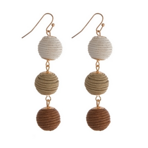 """Gold tone fishhook earrings featuring tan ombre, thread wrapped balls. Approximately 2"""" in length."""