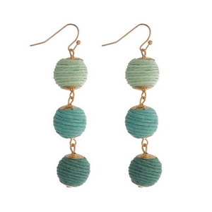 "Gold tone fishhook earrings featuring mint green ombre, thread wrapped balls. Approximately 2"" in length."
