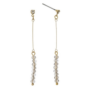 """Dainty gold tone stud earrings featuring gray faceted beads. Approximately 2"""" in length."""
