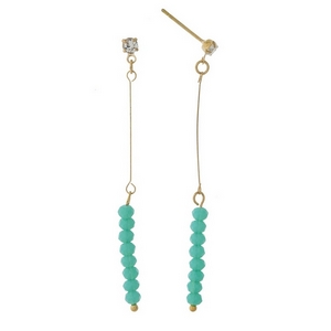 """Dainty gold tone stud earrings featuring turquoise faceted beads. Approximately 2"""" in length."""
