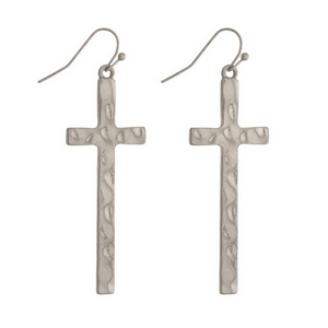 "Silver tone fishhook earrings featuring a hammered cross. Approximately 2"" in length."
