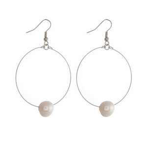 """Silver tone fishhook earrings featuring an open circle and a freshwater pearl bead. Approximately 2"""" in length."""