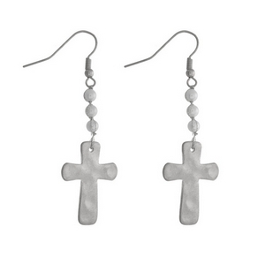 """Silver tone fishhook earrings with a hammered cross and pearl bead accents. Approximately 2"""" in length."""
