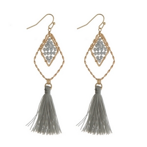 """Gold tone fishhook earrings with gray beads and a fabric tassel. Approximately 3"""" in length."""